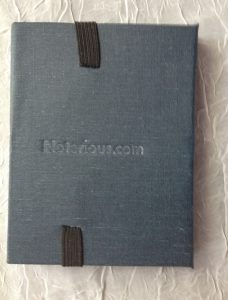 "Blind embossed lettering says ""Noterious.com"""